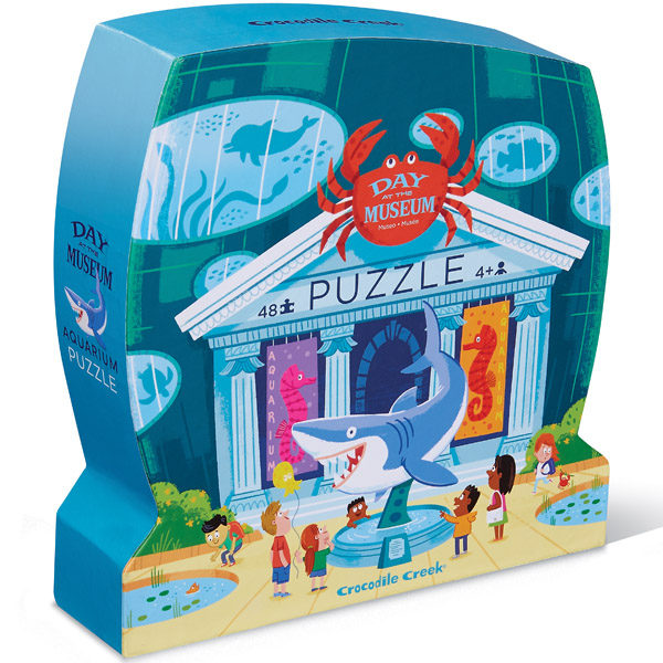 """Crocodile Creek Day at the museum aquarium puzzel 48 stuks vanaf 4j De Day at the museumaquarium puzzel is een educatieve puzzel voor kinderen vanaf 4 jaar. In de mooie silhouet doos zitten 48 stevige kartonnen puzzelstukken. Ontdek al spelenderwijs in het museum de verschillende soorten vissen. De afmeting van """"de dag in het museum aquarium puzzel"""" is 45cm x 60cm. De mooie puzzel is geschikt voor kinderen vanaf 4 jaar. De prachtige puzzels zijn ontworpen in New York door het Amerikaanse merk Crocodile Creek. De puzzel en de verpakking zijn gemaakt van 100% gerecycled karton en gedrukt met inkt op soja basis en watergedragen lak. Ontdek ook uit dezelfde """"Day at the museum"""" collectie de zoo, art,dinosaurus en space puzzels."""