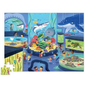 """Crocodile Creek Day at the museum aquarium puzzel 72 stuks vanaf 5j De Day at the museumaquarium puzzel is een educatieve puzzel voor kinderen vanaf 5 jaar. In de mooie 10cm x 23cm ronde doos zitten 72 stevige kartonnen puzzelstukken. Ontdek al spelenderwijs in het museum de verschillende soorten vissen. De afmeting van """"de dag in het museum aquarium puzzel"""" is 35cm x 48cm. De mooie puzzel is geschikt voor kinderen vanaf 5 jaar. De prachtige puzzels zijn ontworpen in New York door het Amerikaanse merk Crocodile Creek. De puzzel en de verpakking zijn gemaakt van 100% gerecycled karton en gedrukt met inkt op soja basis en watergedragen lak. Ontdek ook uit dezelfde """"Day at the museum"""" collectie de dinosaurus en space puzzels met 72 puzzelstukken."""