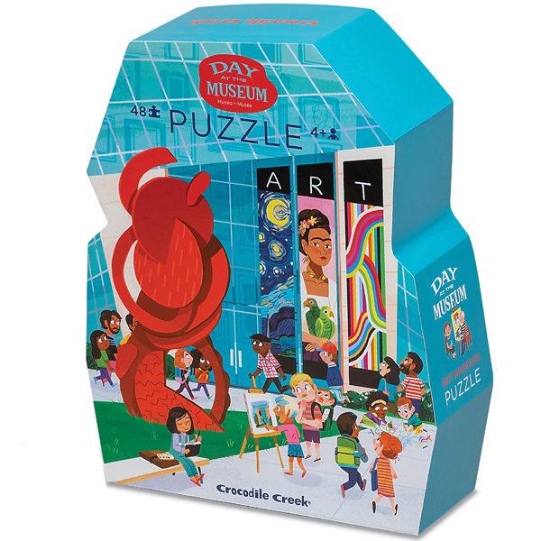 """Crocodile Creek Day at the museum art puzzel 48 stuks vanaf 4j De Day at the museum art puzzel is een educatieve puzzel voor kinderen vanaf 4 jaar.In de mooie silhouet doos zitten 48 stevige kartonnen puzzelstukken.Ontdek in de verschillende ruimten van het museum de kunstwerken van de schilders.De dag in het museum puzzel is 45cm x 60cm en ideaal voor kinderen vanaf 4 jaar.De prachtige puzzels zijn ontworpen in New York door het Amerikaanse merk Crocodile Creek.De puzzel en de verpakking zijn gemaakt van 100% gerecycled karton en gedrukt met inkt op soja basis en watergedragen lak.Ontdek ook uit dezelfde """"Day at the museum"""" collectie de zoo, aquarium,dinosaurus en space puzzels."""