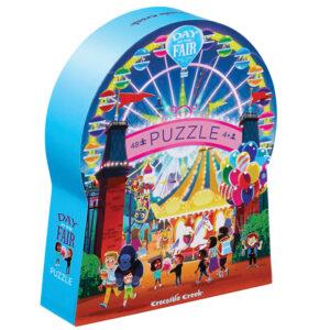 """Crocodile Creek Day at the fair puzzel 48 stuks vanaf 4j De Day at the fair puzzel is een educatieve puzzel voor kinderen vanaf 4 jaar. In de mooie silhouet doos zitten 48 stevige kartonnen puzzelstukken. De afmeting van """"de dag in de kermis puzzel"""" is 45cm x 60cm. De mooie puzzel is geschikt voor kinderen vanaf 4 jaar. De prachtige puzzels zijn ontworpen in New York door het Amerikaanse merk Crocodile Creek. De puzzel en de verpakking zijn gemaakt van 100% gerecycled karton en gedrukt met inkt op soja basis en watergedragen lak. Ontdek ook uit dezelfde """"Day at the museum"""" collectie de zoo,art, aquariumen space puzzels."""